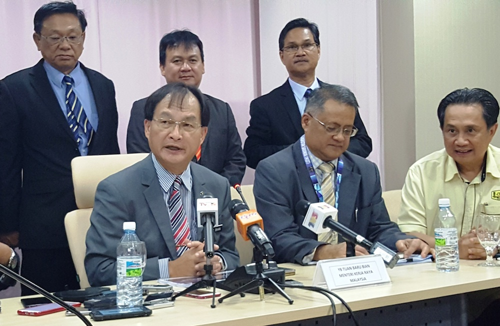 Works Minister Baru Bian (seated, left) speaks at a press conference in Kuching July 9, 2018. — Picture by Sulok Tawie